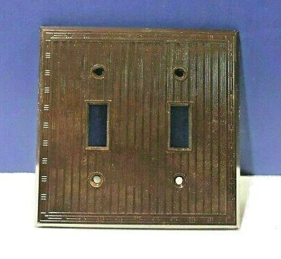 brown double gang plastic light switch wall